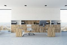 White brick CEO office interior. White brick wall office interior of a company leader with a concrete floor, loft windows and wooden furniture. 3d rendering mock royalty free illustration