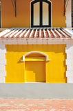 White brick frame with yellow wall and windows European style Royalty Free Stock Photography