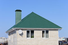 White brick house with green roof Royalty Free Stock Images