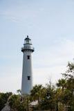 White Brick Lighthouse Beyond Trees Royalty Free Stock Photo