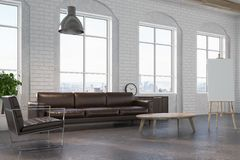 White brick living room, brown sofa side. White brick living room interior with a leather sofa and armchair, a coffee table and an easel with a blank canvas on Royalty Free Stock Photos