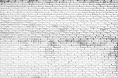 White brick wall background, grungy rusty blocks of stonework. Architecture wallpaper Royalty Free Stock Images