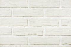 White brick wall background photo, yellow toned Stock Image