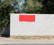 White brick wall background with red banner. Royalty Free Stock Image