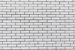 White brick wall, background texture. White brick wall for design. Seamless texture, detailed background texture. The white surface of the stone blocks Royalty Free Stock Photography
