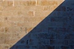 White brick wall background. Whitewash brick wall horizontal flat background with diagonal shadow Stock Images
