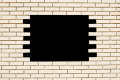 White brick wall. with black hole. White brick wall. Square with space for text Stock Photos