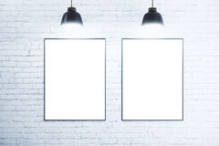 White brick wall with blank white posters Royalty Free Stock Photography