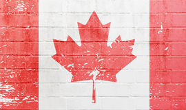 White brick wall with Canadian flag Stock Image