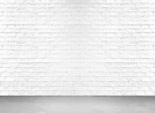 White brick wall and cement floor Stock Image