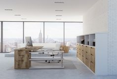 White brick wall CEO office interior, side view. Side view of a white brick wall company leader office corner with a concrete floor, loft windows and wooden stock illustration