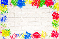 White brick wall with colorful frame Stock Photography