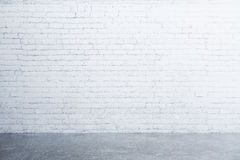 White brick wall and concrete floor in empty room Royalty Free Stock Photography