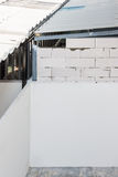 White brick wall. For extension part behind the urban house stock image