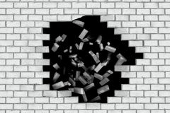 White brick wall falling down making a hole. Black background Stock Photo