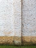 White brick wall with flood dirt mark on a farm house. In brazil - vertical royalty free stock images