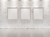 WHITE BRICK WALL with frames for paintings Stock Photography