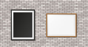 White brick wall with frames Stock Photo