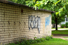 White brick wall and graffiti Royalty Free Stock Photo