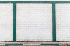 White brick wall with green decor Royalty Free Stock Photo