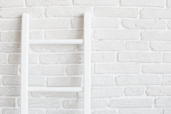White brick wall with ladder Stock Photos