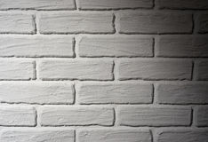 White brick wall with light effect and shadow, abstract background photo Royalty Free Stock Photo