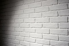 White brick wall with light effect and shadow, abstract background photo, side view Royalty Free Stock Photography
