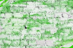 Brick wall painted with green paint royalty free stock photography