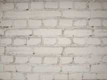 White brick wall. Old brick wall covered with white paint royalty free stock images