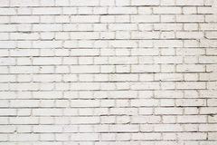 White brick wall outdoor background. A new brick wall in white. It stands outdoor. For texture or background. A brick wall painted white. The window faces a stock photos