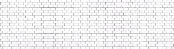 White brick wall panoramic background for design. White brick wall background texture of stone blocks light, panorama Royalty Free Stock Image