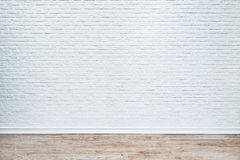 White brick wall and plank wood floor. White brick wall and plank wood floor background stock photo