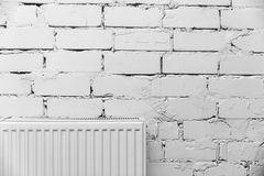 White brick wall with radiator Stock Image