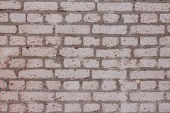 White brick wall in red dots. As texture or background royalty free stock photography