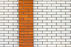 White brick wall with red stripe Stock Photography