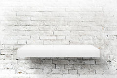 White brick wall and shelf Royalty Free Stock Photos