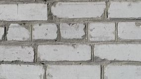 The white brick wall. Slow motion movement stock video