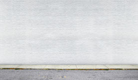 White brick wall on the street. Painted on white and clear brick wall on the street stock image