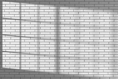 White brick wall with sunlight from window Stock Image