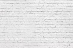 White brick wall background, texture of whitened masonry royalty free stock photography