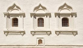 White brick wall with three  arched window. Royalty Free Stock Photo