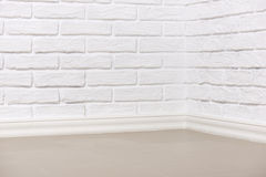 White brick wall with tiled floor, abstract background photo Royalty Free Stock Photos