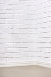 White brick wall with tiled floor, abstract background photo Royalty Free Stock Images