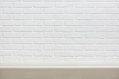 White brick wall with tiled floor, abstract background photo Stock Photography