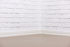 White brick wall with tiled floor, abstract background photo Stock Photo