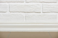 White brick wall with tiled floor closeup photo, abstract background photo Stock Images
