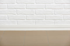 White brick wall with tiled floor closeup photo, abstract background photo Royalty Free Stock Photography