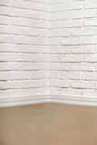 White brick wall with tiled floor and corner, abstract background photo Stock Photo