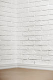 White brick wall with tiled floor and corner, abstract background photo Stock Photography