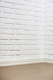 White brick wall with tiled floor and corner, abstract background photo Royalty Free Stock Photo
